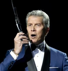 Michael Buffer anouncing into microphone