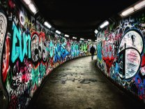 graffiti marked walls of a tunnel image