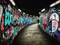 graffiti marked walls of a tunnel image